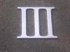 Alumíniumból kivágott római számok.